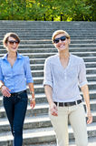 Two  beautiful woman with sunglasses on the stairs Stock Photography