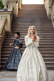 Two beautiful woman in vintage dress on nature Royalty Free Stock Photos