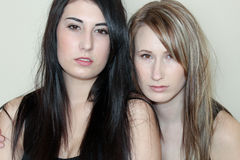 Two beautiful women. Posing together Royalty Free Stock Photos