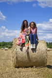Two beautiful women on an agriculture field Stock Photography