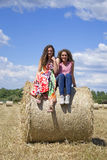 Two beautiful women on an agriculture field Royalty Free Stock Image