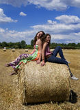 Two beautiful women on an agriculture field Royalty Free Stock Photo
