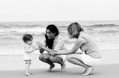 Two beautiful women with a baby Stock Images