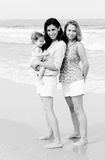 Two beautiful women with a baby Royalty Free Stock Photo