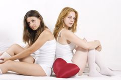 Two beautiful women on bed Royalty Free Stock Photos