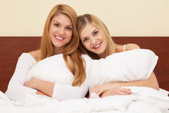 Two beautiful women in bed Stock Photography