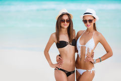 Two beautiful women in bikini and fashionable hats Royalty Free Stock Images