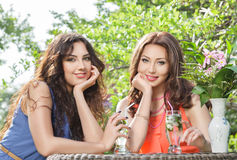 Two beautiful women at cafe Stock Images