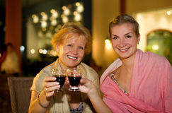 Two beautiful women celebrating Royalty Free Stock Image