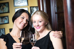 Two beautiful women celebrating with champagne Royalty Free Stock Photo
