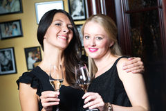 Two beautiful women celebrating with champagne Royalty Free Stock Image