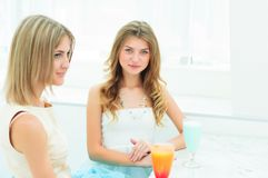 Two beautiful women chatting in a cafe Royalty Free Stock Photo