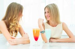 Two beautiful women chatting in a cafe Royalty Free Stock Images