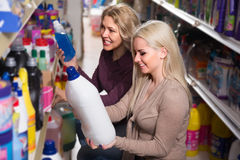 Two beautiful women choosing some detergents. In the shop Stock Photo
