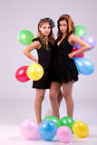 Two beautiful women, with colored ballons Royalty Free Stock Image