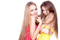 Two beautiful women in a colored dress Stock Photography