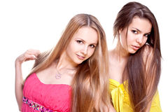 Two beautiful women in a colored dress Stock Images