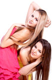 Two beautiful women in a colored dress Stock Photos