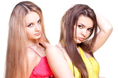 Two beautiful women in a colored dress Stock Image