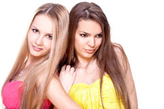 Two beautiful women in a colored dress Stock Photo