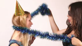 Two beautiful women dancing in photo booth stock video footage