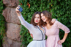 Two beautiful women doing Selfe Royalty Free Stock Photos