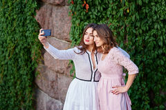 Two beautiful women doing Selfe Royalty Free Stock Image