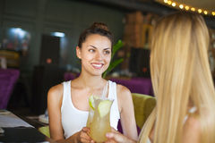 Two beautiful women drinking cocktails Royalty Free Stock Photo