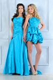 Two beautiful women in evening dresses. Royalty Free Stock Images