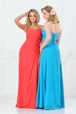 Two beautiful women in evening dresses Royalty Free Stock Images