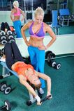 Two beautiful women exercise in gym with weights Stock Photo