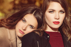 Two Beautiful Women Fashion Models with Makeup and Hairstyle Royalty Free Stock Photography