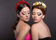 Two beautiful women with flower's headbands Stock Photo