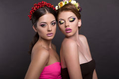 Two beautiful women with flower's headbands Royalty Free Stock Images