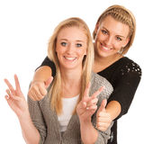 Two beautiful women gesturing success Royalty Free Stock Photography