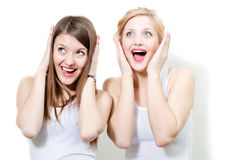 Two beautiful women girlfriends amazed Stock Photos