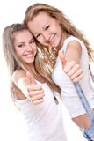 Two beautiful women giving thumbs-up Royalty Free Stock Photography