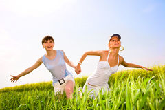 Two beautiful women go to the yellow flowers. Two beautiful women in white clothes go to the yellow flowers Royalty Free Stock Photo