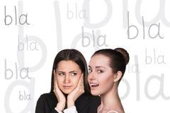 Two beautiful women gossiping Royalty Free Stock Photography