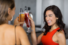 Two beautiful women having cocktail. In restaurant Stock Photos