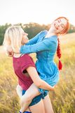 Two best friends spend time outdoors. Two beautiful women having fun outdoors. Best friends stock photo