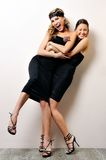 Two beautiful women having fun together. Stock Images