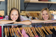 Two beautiful women with head on hand smiling at camera Royalty Free Stock Photo