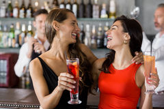 Two beautiful women holding cocktail glass. In restaurant Royalty Free Stock Photography