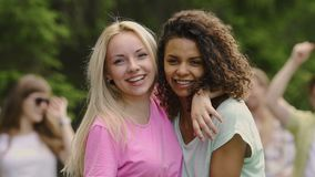 Two beautiful women hugging, posing at camera, young people celebrating life. Stock footage stock video footage