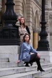 Two beautiful women at a lantern Stock Image