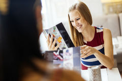 Two beautiful women looking at menu Stock Photos