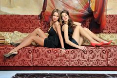 Two beautiful women in luxury interior. Royalty Free Stock Image