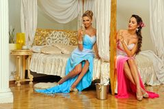 Two beautiful women in luxury interior. stock photography