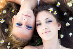 Two beautiful women lying head to head Stock Photography